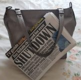 Open Up Arayla Handbag with Newspaper About the Shutdown