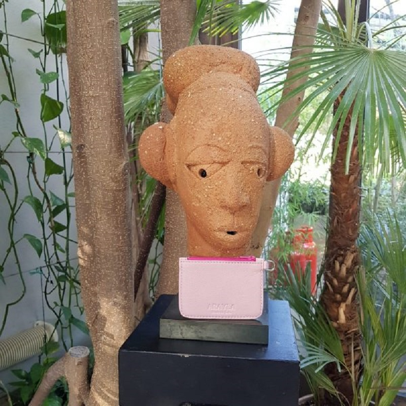 Culture Shock Sculpted Head with Arayla Handbag in Front