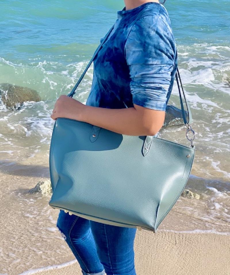 Los Angeles Woman on a Beach with a Handbag