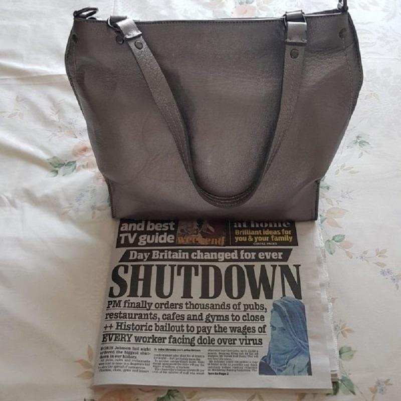 Open Up an Arayla Handbag With Newspaper About the Shutdown