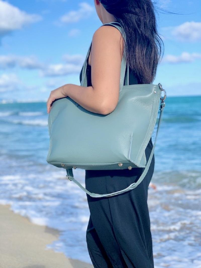 Los Angeles a Woman on the Beach with a Handbag