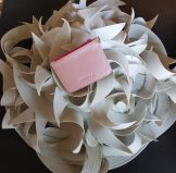 Art of Creativity Arayla Handbag on a White Sculpture