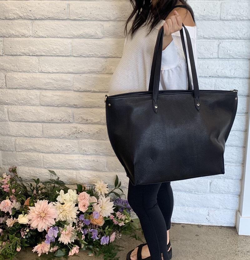 Woman Posing with a Mama Bag