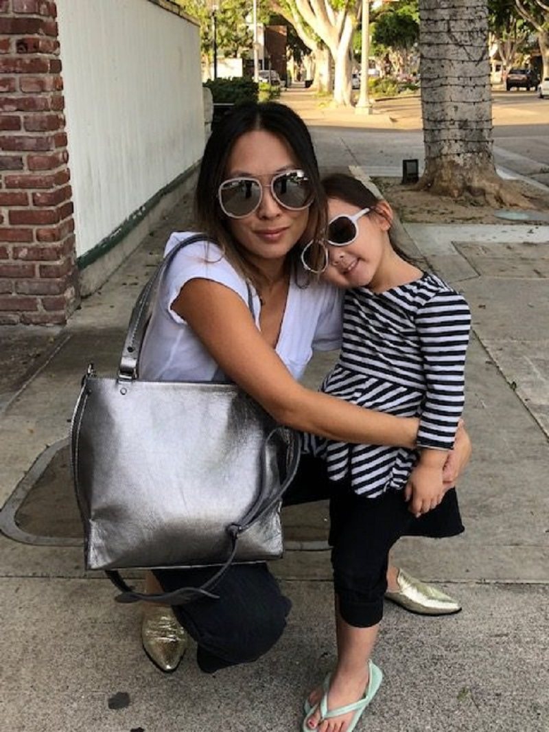 Woman with a Child and a Mama Bag