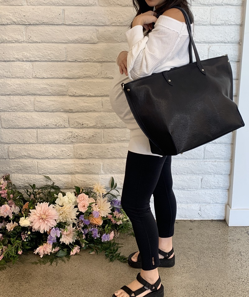 Woman Holding a Mama Bag