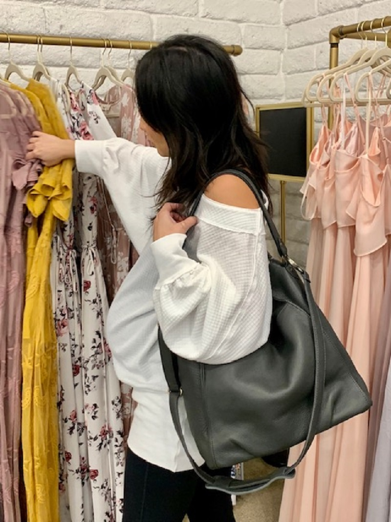 Woman with a Mama Bag Shopping for Dresses