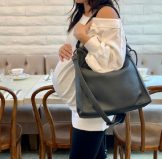 Woman at a Restaurant with a Mama Bag
