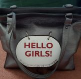 "Positive Messaging Arayla Handbag with a ""Hello"" Sign"