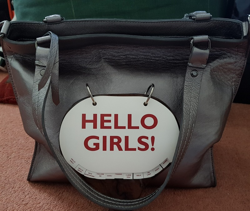 "Positive Messaging Arayla Handbag with a ""Hello"" Sign"